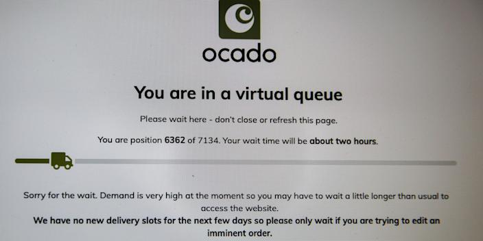 A screenshot of Ocado's website, showing more than 7,100 people lining up to go online grocery shopping with a wait time of two hours, on March 18, 2020.