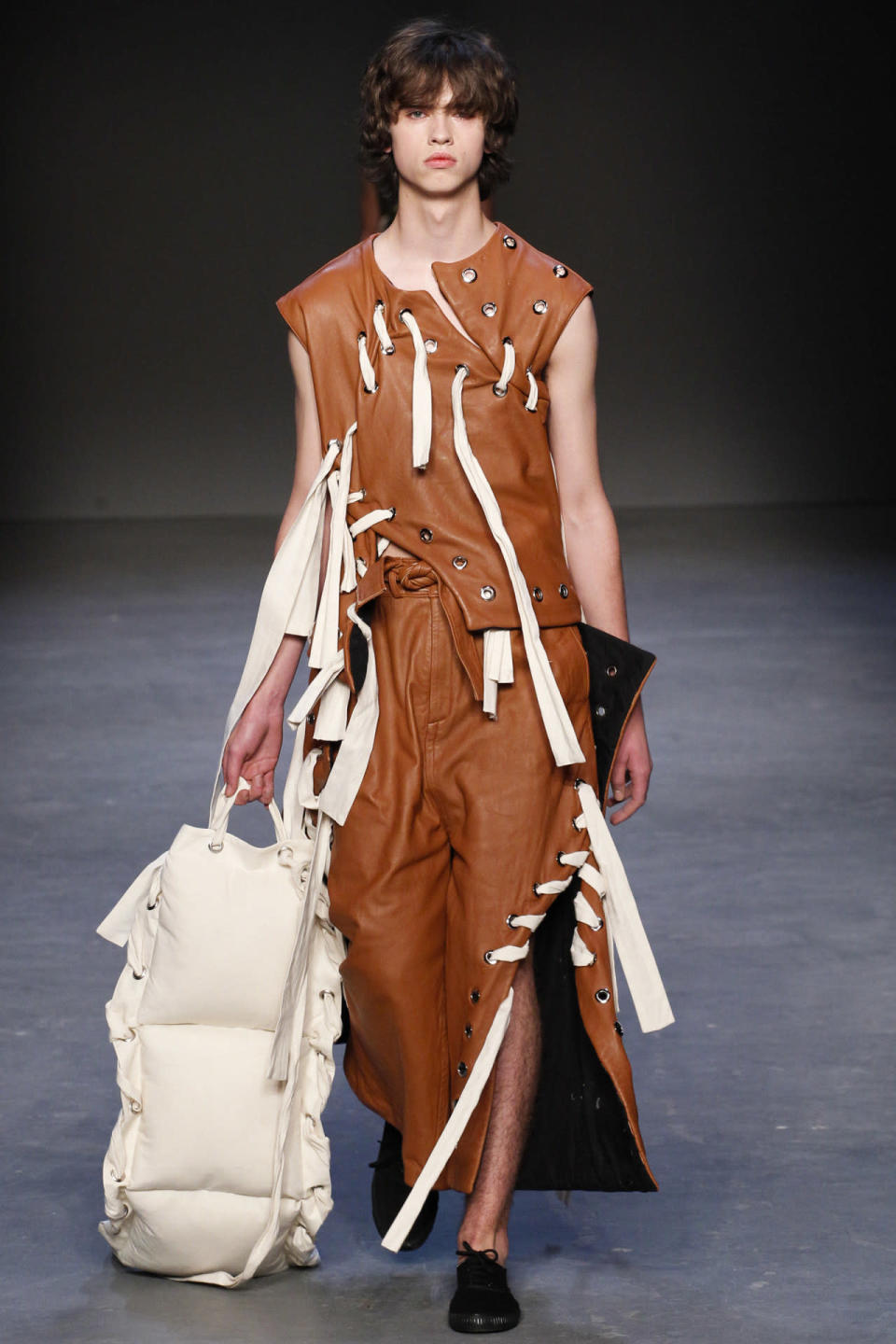 <p>This bondage like outfit could have also been mistaken for a baseball glove or even a football.<i> Photo: Getty Images</i></p>