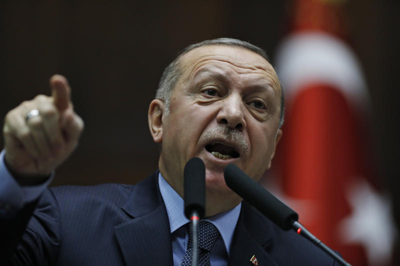 "Turkey's President Recep Tayyip Erdogan gestures as he delivers a speech to MPs of his ruling Justice and Development Party (AKP) at the parliament in Ankara, Turkey, Tuesday, Jan. 8, 2019. Erdogan said Turkey's preparations for a new military offensive against terror groups in Syria are ""to a large extent"" complete. Erdogan made the comments just hours after U.S. national security adviser John Bolton met with Turkish officials seeking assurances that Turkey won't attack U.S-allied Kurdish militia in Syria. (AP Photo/Burhan Ozbilici)"