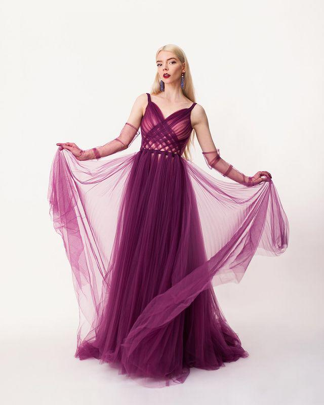 """<p>in a <a href=""""https://www.instagram.com/p/CMKPCWCpm2o/"""" rel=""""nofollow noopener"""" target=""""_blank"""" data-ylk=""""slk:&quot;floaty&quot; Dior Haute Couture gown"""" class=""""link rapid-noclick-resp"""">""""floaty"""" Dior Haute Couture gown</a> featuring braided detailing at the waist, plus Bulgari jewelry and a Dior makeup look which she created herself with virtual<a href=""""https://www.instagram.com/p/CMJPi1OguCd/"""" rel=""""nofollow noopener"""" target=""""_blank"""" data-ylk=""""slk:help from pro Georgie Eisdell"""" class=""""link rapid-noclick-resp""""> help from pro Georgie Eisdell</a>. """"It was a more structured look to offset the gorgeous and whimsical Dior gown,"""" Eisdell said of her makeup moment, featuring a bold matching lip created with <a href=""""https://www.dior.com/en_us/products/beauty-Y0179009_C017900943-dior-contour-no-transfer-lip-liner-pencil-intense-couture-color-long-wear"""" rel=""""nofollow noopener"""" target=""""_blank"""" data-ylk=""""slk:Dior Euphoric Liner"""" class=""""link rapid-noclick-resp""""> Dior Euphoric Liner</a> and <span>Dior Rouge Dior Lipstick in Opera</span>. </p>"""