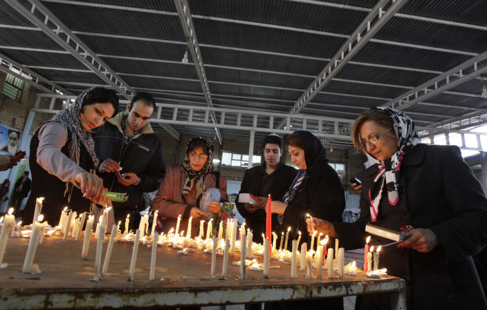 In this picture taken on Thursday, Feb. 16, 2012, Iranian Jews light candles as they pray at the shrine of biblical prophet Daniel, in the city of Susa, some 450 miles ( 750 kilometers) southwest of the capital Tehran, Iran. All but lost amid the heated talk about a possible Israeli attack on Iran's suspect nuclear program are the thousands of Jews who live in the Islamic Republic and could be caught in the middle. (AP Photo/Vahid Salemi)