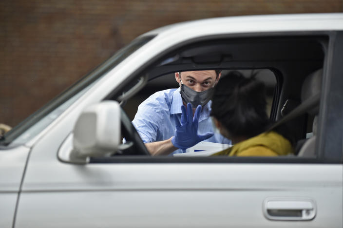 Georgia Democratic candidate for U.S. Senate Jon Ossoff waves after giving a yard sign to a supporter during a drive-through yard sign pick-up event on November 22, 2020. (Photo by Austin McAfee/Icon Sportswire)