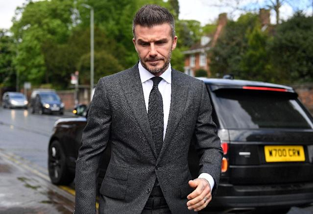 David Beckham, pictured on his way to court this week, cheered Salford into the English Football League as the club he co-owns with Manchester United's famous 'Class of 92' clinched a 3-0 win against AFC Fylde in the National League play-off final on Saturday (AFP Photo/Daniel LEAL-OLIVAS)