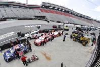 Crews wait to push their cars through the inspection lane before the NASCAR All-Star auto race at Bristol Motor Speedway in Bristol, Tenn, Wednesday, July 15, 2020. (AP Photo/Mark Humphrey)