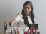 Revlon CEO Debra Perelman, the company's first woman CEO in its 89-year-old history, show products during an interview, Wednesday Aug. 18, 2021, in New York. Revlon was already facing big challenges when Perelman took over as the first woman CEO in its 89-year-old history in 2018. But Perelman says she is optimistic about the brand's future, pointing to steps she has taken to accelerate e-commerce and being more nimble in the face of competition. (AP Photo/Bebeto Matthews)