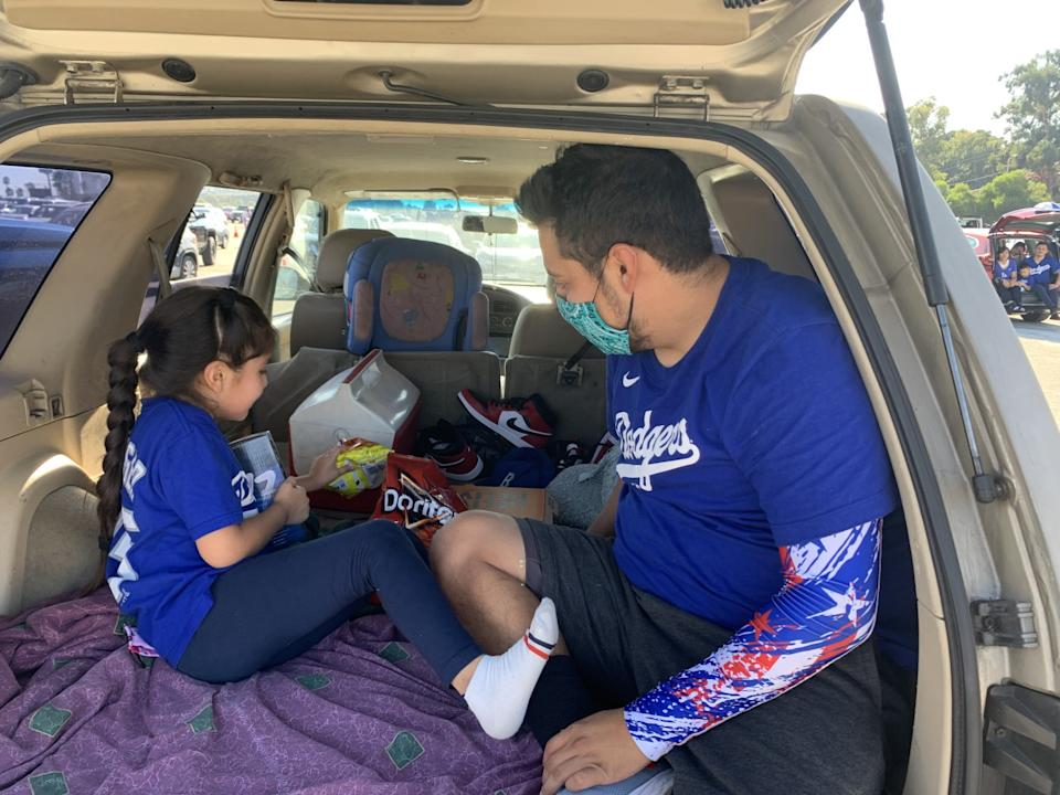 Erik Garcia brought little sister Melissa to the Dodgers' drive-in watch party of Game 2 of the NLCS.