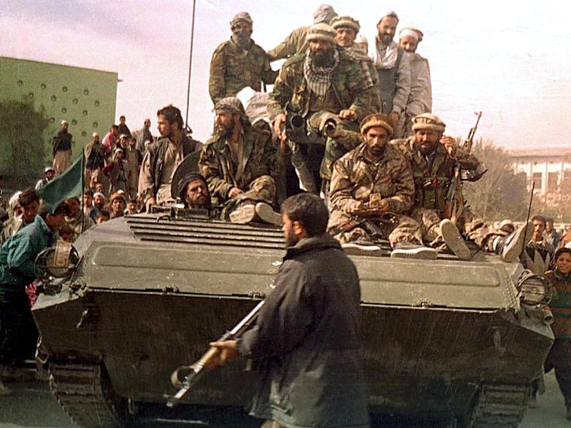 In a November 2001 photograph taken by AFP's Shah Marai, who was killed covering a suicide bombing on Monday, security forces from the Northern Alliance group enter Kabul during the fall of the Taliban regime (AFP Photo/Shah MARAI)