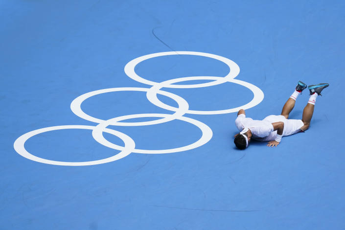 Fabio Fognini, of Italy, reacts after losing a point to Daniil Medvedev, of the Russian Olympic Committee, during the third round of the men's tennis competition at the 2020 Summer Olympics, Wednesday, July 28, 2021, in Tokyo, Japan. (AP Photo/Patrick Semansky)