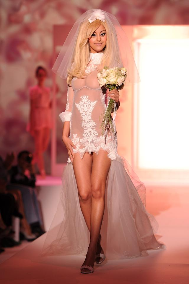 PARIS, FRANCE - JULY 02:  Zahia Dehar walks the runway during the Zahia Couture show as part of Paris Fashion Week Fall / Winter 2013 at Hotel Salomon de Rothschild on July 2, 2012 in Paris, France.  (Photo by Pascal Le Segretain/Getty Images)