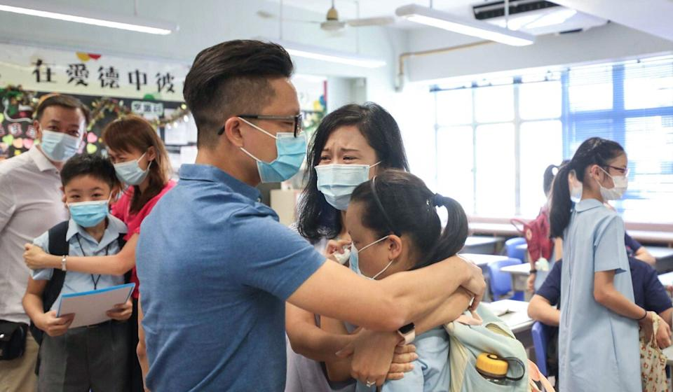 Ellie Wong, her mother Karen Chue, and father Jeff Wong, share a hug after learning Ellie will be attending True Light Girls' College. Photo: Xiaomei Chen