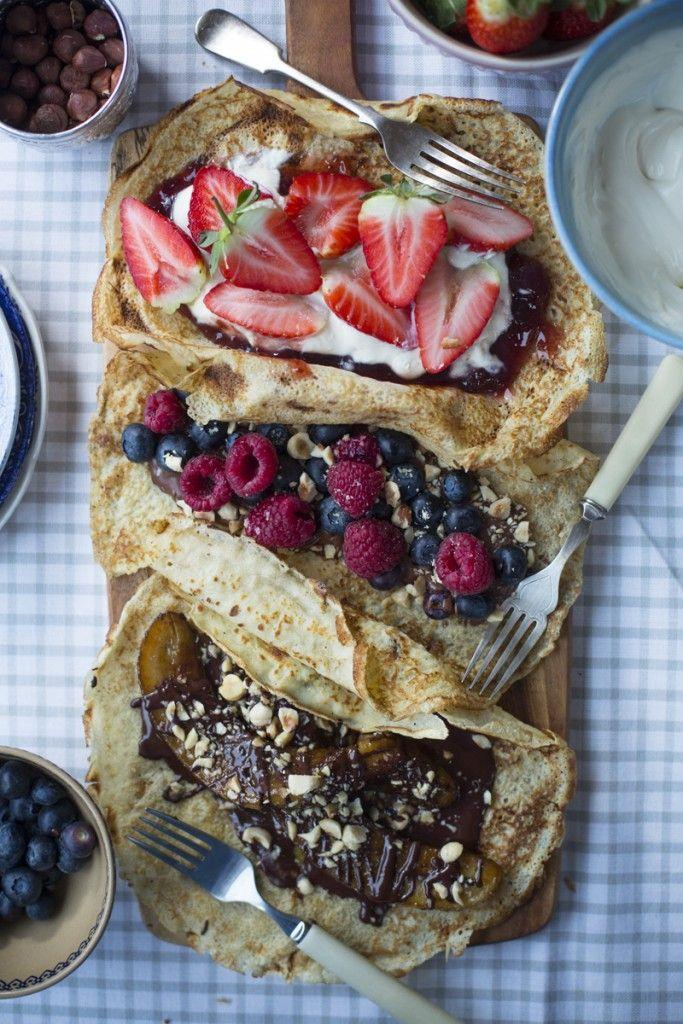 """<p>Irish pancakes are thinner than American ones which makes them perfect for stuffing with fruit, whipped cream, caramelized bananas and hot fudge. </p><p><span class=""""redactor-invisible-space""""><em><a href=""""http://www.donalskehan.com/recipes/pancakes-three-ways/"""" rel=""""nofollow noopener"""" target=""""_blank"""" data-ylk=""""slk:Get the recipe from Donal Skehan »"""" class=""""link rapid-noclick-resp"""">Get the recipe from Donal Skehan »</a></em></span><strong><br></strong></p><p><span class=""""redactor-invisible-space""""><strong>RELATED:</strong> <a href=""""https://www.goodhousekeeping.com/food-recipes/cooking/g19502511/how-to-make-whipped-cream/"""" rel=""""nofollow noopener"""" target=""""_blank"""" data-ylk=""""slk:How to Make the Perfect Whipped Cream From Scratch"""" class=""""link rapid-noclick-resp"""">How to Make the Perfect Whipped Cream From Scratch</a><br></span></p>"""