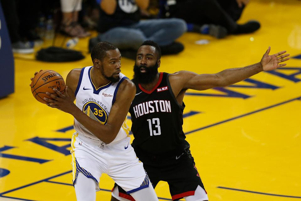 OAKLAND, CALIFORNIA - MAY 08: Kevin Durant #35 of the Golden State Warriors is guarded by James Harden #13 of the Houston Rockets during Game Five of the Western Conference Semifinals of the 2019 NBA Playoffs at ORACLE Arena on May 08, 2019 in Oakland, California. NOTE TO USER: User expressly acknowledges and agrees that, by downloading and or using this photograph, User is consenting to the terms and conditions of the Getty Images License Agreement. (Photo by Lachlan Cunningham/Getty Images)