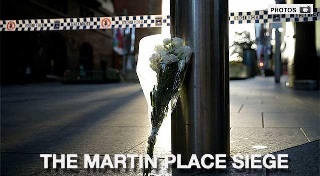 IN PICTURES: A timeline of the siege that took place at the Lindt Cafe in Martin Place and the tributes that followed after. Photo: AAP
