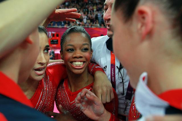 Gabrielle Douglas of the United States celebrates with teammates during the Artistic Gymnastics Women's Team final on Day 4 of the London 2012 Olympic Games at North Greenwich Arena on July 31, 2012 in London, England. (Photo by Ronald Martinez/Getty Images)