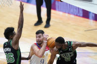 New Orleans Pelicans center Willy Hernangomez (9) battles under the basket between Boston Celtics forward Aaron Nesmith (26) and guard Kemba Walker (8) in the first half of an NBA basketball game in New Orleans, Sunday, Feb. 21, 2021. (AP Photo/Gerald Herbert)