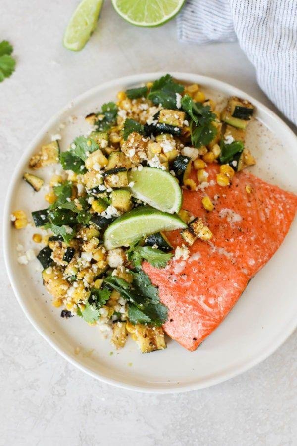 """<p>Salmon provides this dish with plenty of protein, but the real star is the elote-style vegetables. Add cotija cheese, lime juice, and cilantro to really amplify the vibe. </p><p><a class=""""link rapid-noclick-resp"""" href=""""https://therealfoodrds.com/grilled-salmon-with-elote-style-veggies/"""" rel=""""nofollow noopener"""" target=""""_blank"""" data-ylk=""""slk:GET THE RECIPE"""">GET THE RECIPE</a></p><p><em>Per serving: 463 calories, 25 g fat (6 g saturated), 512 mg sodium, 18 g carbs, 4 g fiber, 4 g sugar, 44 g protein</em></p>"""