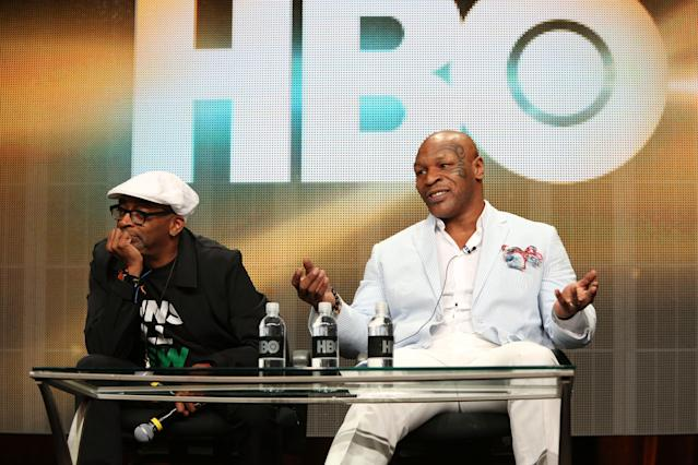 Former heavyweight champion Mike Tyson (R), shown with Spike Lee, is one of many stars in boxing who appeared on HBO. (Photo by FilmMagic/FilmMagic)