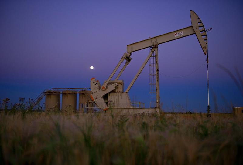 Oil prices fell after the US government reported crude inventories increased again to record highs, adding to concerns about the global supply glut (AFP Photo/Karen Bleier)
