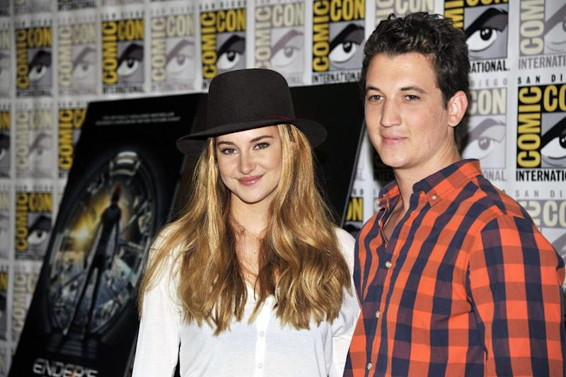 "Shailene Woodley, left, and Miles Teller attend the ""Divergent"" press line on Day 2 of Comic-Con International on Thursday, July 18, 2013 in San Diego, Calif. (Photo by Chris Pizzello/Invision/AP)"