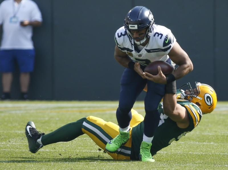 Russell Wilson was pressured most of the game against the Packers on Sunday. (AP)