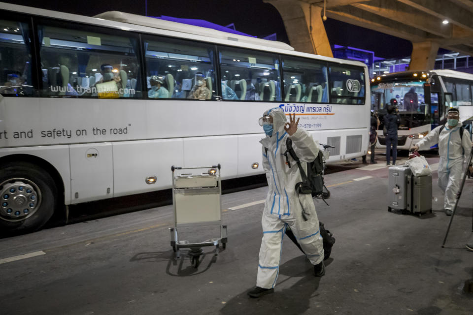 A bus leaves with Chinese tourists from Shanghai, who arrived at Suvarnabhumi airport on special tourist visas, in Bangkok, Thailand, Tuesday, Oct. 20, 2020. Thailand on Tuesday took a modest step toward reviving its coronavirus-battered tourist industry by welcoming 39 visitors who flew in from Shanghai, the first such arrival since normal traveler arrivals were banned almost seven months ago. (AP Photo/Wason Wanichakorn)