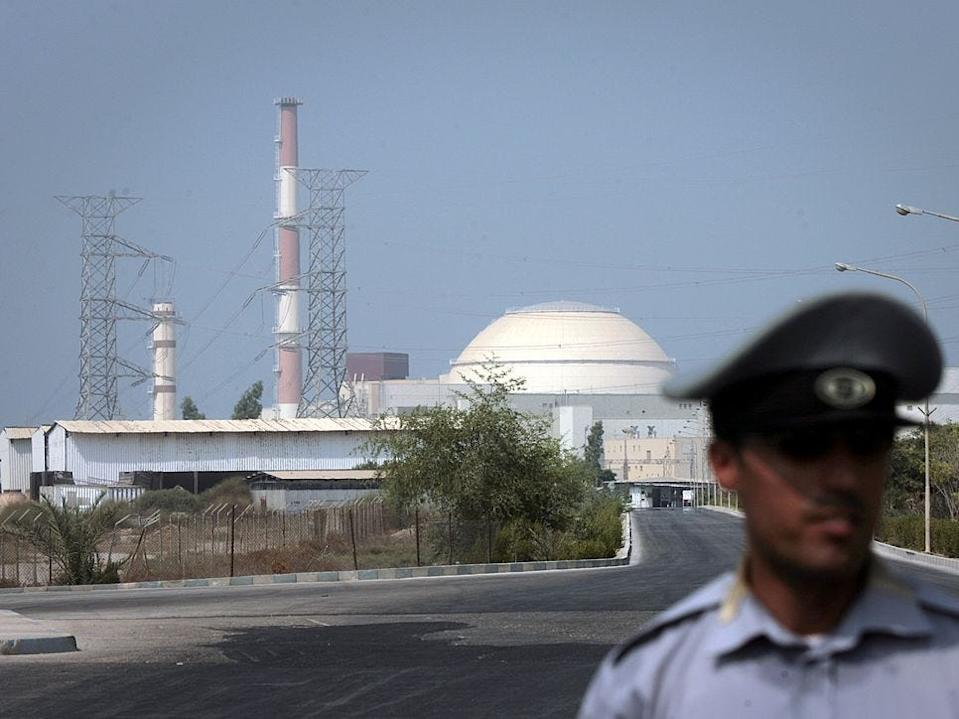An Iranian security guard standing in front of the Bushehr nuclear power plant on August 20, 2010 in southern Iran
