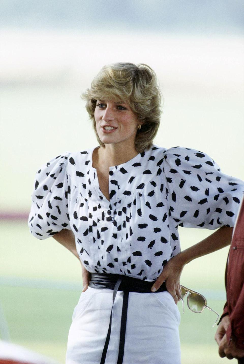 <p>In a printed peasant blouse and obi belt at a Polo Match in Cirencester, England. </p>
