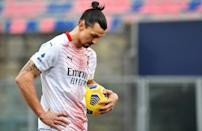 Zlatan Ibrahimovic missed a penalty but AC Milan beat Bologna to stay two points clear of Inter at the top of Serie A