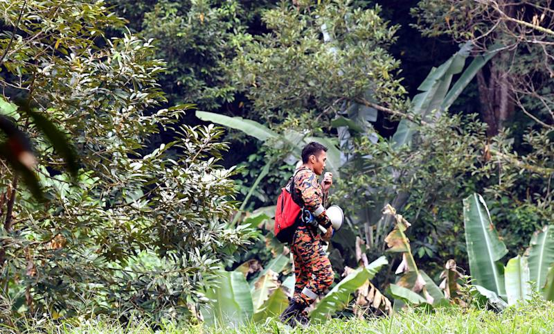 A rescuer holds a bullhorn while participating in the search for missing Irish teen Nora Anne Quoirin in the jungle near Seremban August 9, 2019. — Bernama pic