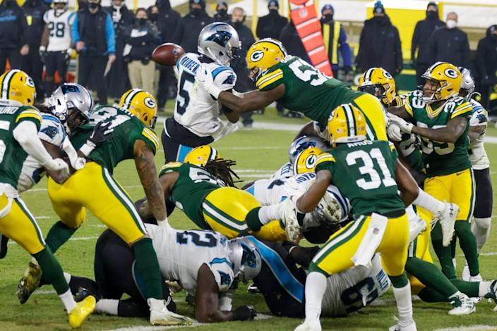 Green Bay's Krys Barnes knocks the ball away from Carolina Panthers quarterback Teddy Bridgewater on Dec. 19th. Panthers head coach Matt Rhule said later that the coaching staff had taught the players not to stick the ball out at the goal line.