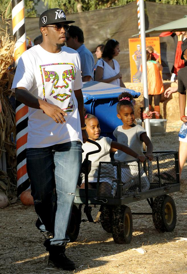 86253, LOS ANGELES, CALIFORNIA - Saturday October 27, 2012. **EXCLUSIVE** Sean Combs aka 'P-Diddy' seen with his daughters D'Lila and Jessie enjoying an afternoon of pumpkin carving at the Mr Bones Pumpkin Patch in Hollywood. Photograph: ©Anthony Monterotti, PacificCoastNews.com **FEE MUST BE AGREED PRIOR TO USAGE** **E-TABLET/IPAD & MOBILE PHONE APP PUBLISHING REQUIRES ADDITIONAL FEES** LOS ANGELES OFFICE: 1 310 822 0419 LONDON OFFICE: 44 20 8090 4079