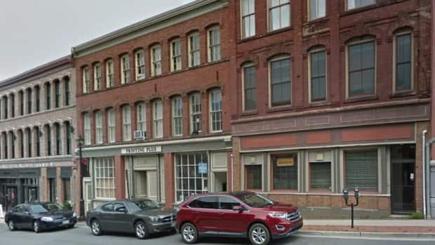 52 Canterbury St., centre, houses a printing shop on the ground floor, other businesses on the second floor, and the third floor is currently rented out to musicians. (Google Street View - image credit)