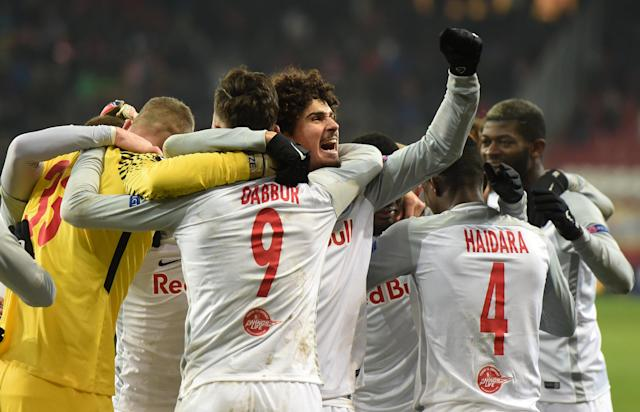 Soccer Football - Europa League Round of 32 Second Leg - RB Salzburg vs Real Sociedad - Red Bull Arena Salzburg, Salzburg, Austria - February 22, 2018 RB Salzburg's Moanes Dabour, Andre Ramalho and team mates celebrate at the end of the match REUTERS/Andreas Gebert