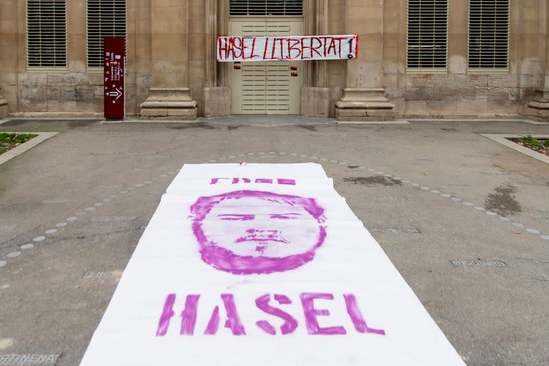 A poster with the image of Catalan rap singer Pablo Hasel is seen in front of the rectory of the University of Lleida