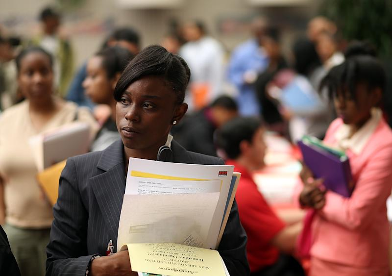 SAN FRANCISCO, CA - MAY 30: Job seekers wait in line to meet with a recruiter during a job and career fair at City College of San Francisco southeast campus on May 30, 2013 in San Francisco, California. Hundreds of job seekers attended a career fair hosted by the San Francisco Southeast Community Facility Commission. (Photo by Justin Sullivan/Getty Images)