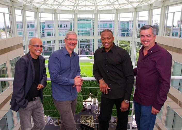 From left to right: Beats cofounder Jimmy Iovine, Apple CEO Tim Cook, Beats cofounder Dr. Dre, and Apple senior VP Eddy Cue.