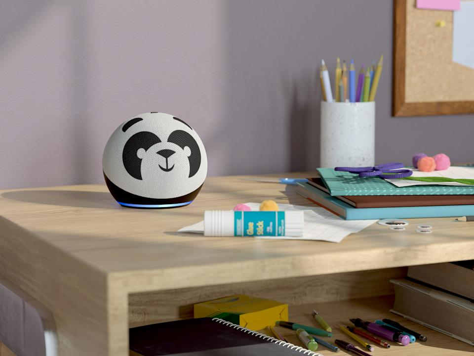 Panda Echo Dot on a table full of craft supplies