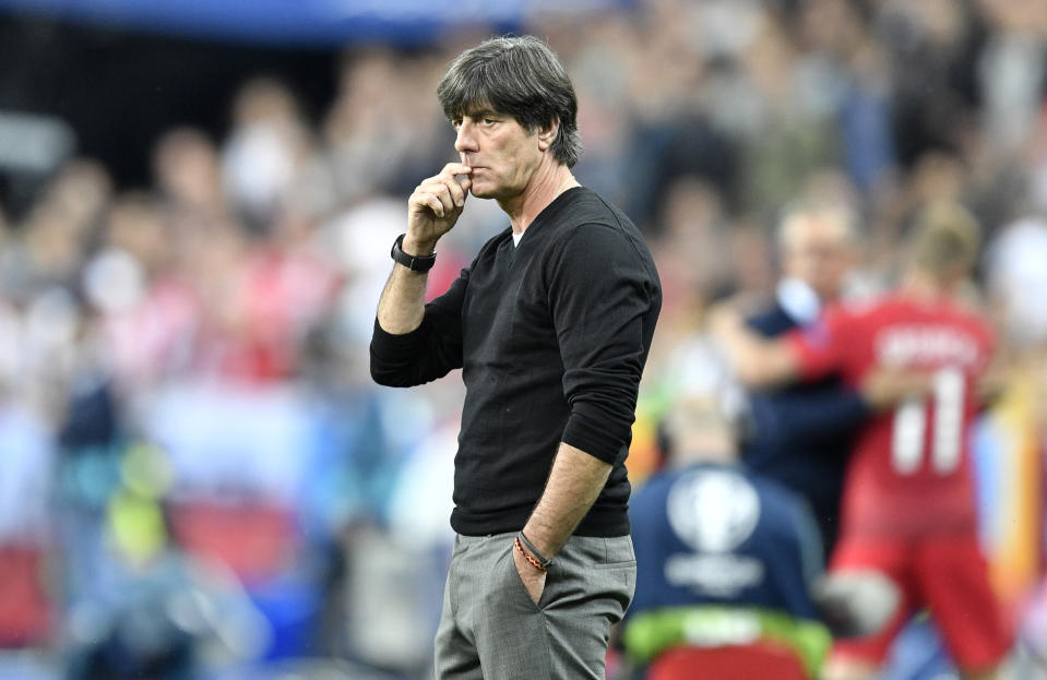 FILE - In this Thursday, June 16, 2016 filer, Germany coach Joachim Loew looks from the sidelines during the Euro 2016 Group C soccer match between Germany and Poland at the Stade de France in Saint-Denis, north of Paris, France. France won the last major international soccer tournament — the World Cup in 2018 — by defending compactly, hitting teams on the break with clinical finishing, and being effective at set pieces. What will the winning approach be at the European Championship?. (AP Photo/Martin Meissner, File)