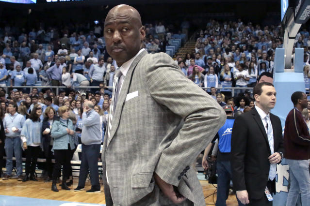 FILE - In this Tuesday, March 3, 2020 file photo, Wake Forest head coach Danny Manning leaves the court after the team lost to North Carolina in an NCAA college basketball game in Chapel Hill, N.C. On Saturday, April 25, 2020, Wake Forest announced it has fired Manning after six seasons in which the Demon Deacons had a winning record only once. (AP Photo/Chris Seward)