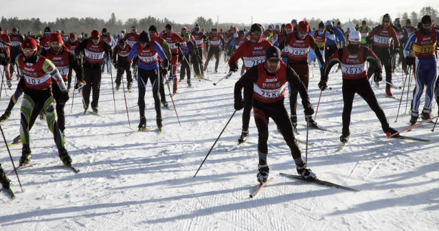 Competitors start the American Birkebeiner ski race in Cable, Wis., on Saturday, Feb. 22, 2014. The race covers 50 kilometers to Hayward, Wis. (AP Photo/Paul M. Walsh)