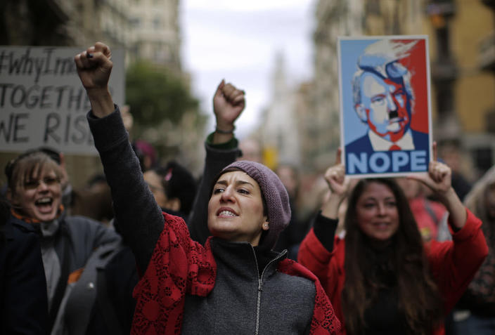 <p>People shout slogans during the Women's March rally in Barcelona Jan. 21. (AP Photo/Manu Fernandez) </p>