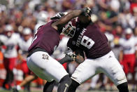 Texas A&M defensive linemen Micheal Clemons (2) and DeMarvin Leal (8) react after sacking New Mexico quarterback Terry Wilson (2) for an 8-yard loss during the first half of an NCAA college football game on Saturday, Sept. 18, 2021, in College Station, Texas. (AP Photo/Sam Craft)
