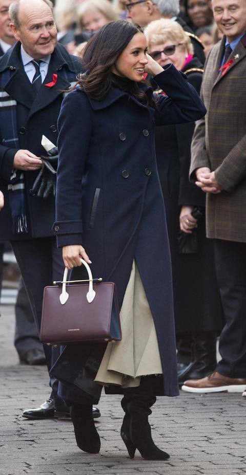 Meghan Markle wearing a Mackage coat and Strathberry bag in Nottingham in December