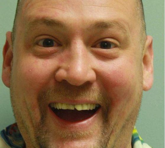 """Few people posing for a mug shot have the sunny disposition shown by David Kalb. The 41-year-old resident of Greensburg, Pennsylvania, posed for this magical photo after state troopers discovered <a href=""""http://www.huffingtonpost.com/entry/david-kalb-cheerful-mug-shot_56685684e4b080eddf56631d?utm_hp_ref=mug-shots"""" target=""""_blank"""">70 psychedelic mushroom plants</a> and other drug paraphernalia inside his public housing apartment."""