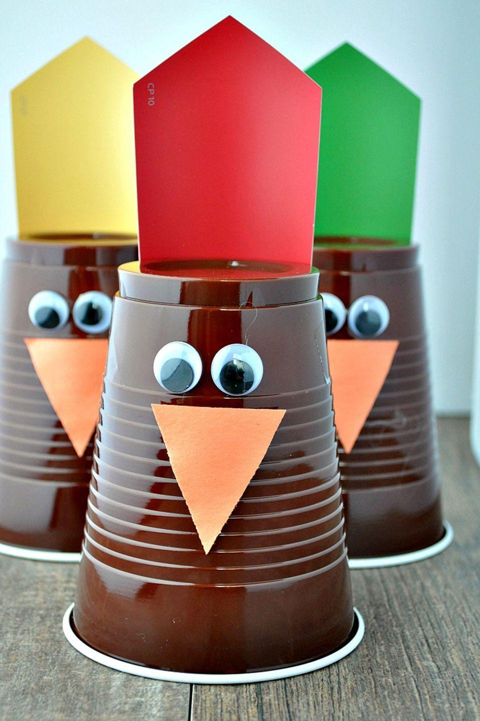 """<p>Use mini pumpkins to knock over as many turkeys as you can! </p><p><strong>Get the tutorial at <a href=""""http://www.theseasonedmom.com/thanksgiving-game-turkey-bowling/"""" rel=""""nofollow noopener"""" target=""""_blank"""" data-ylk=""""slk:The Seasoned Mom"""" class=""""link rapid-noclick-resp"""">The Seasoned Mom</a>.</strong></p><p><a class=""""link rapid-noclick-resp"""" href=""""https://www.amazon.com/Amscan-Party-Plastic-16-Ounce-Chocolate/dp/B004UPYM00/?tag=syn-yahoo-20&ascsubtag=%5Bartid%7C10050.g.4698%5Bsrc%7Cyahoo-us"""" rel=""""nofollow noopener"""" target=""""_blank"""" data-ylk=""""slk:SHOP BROWN CUPS"""">SHOP BROWN CUPS</a></p>"""