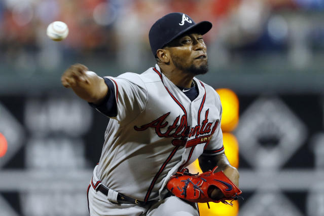 FILE - In this Sept. 12, 2019, file photo, Atlanta Braves' Julio Teheran throws during a baseball game against the Philadelphia Phillies in Philadelphia. The Los Angeles Angels have agreed to a $9 million, one-year contract with the right-hander, a person familiar with the negotiations told The Associated Press, Thursday, Dec. 19, 2019. Teheran spent the past seven seasons with Atlanta. The Braves declined his $12 million option. (AP Photo/Matt Slocum, File)