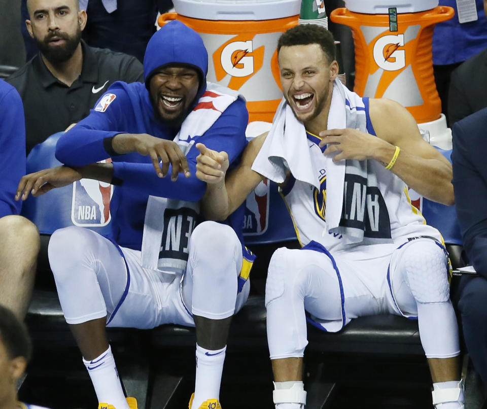 Kevin Durant and Stephen Curry have found the joy in combining their super powers. (AP)