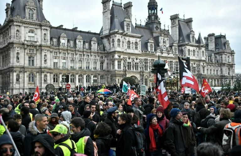 Demonstrators turned out across France Saturday to show their support for the strikes against pensions reform (AFP Photo/STEPHANE DE SAKUTIN)