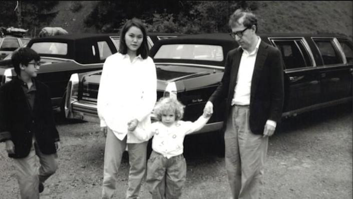 """A photograph of Moses Farrow, Soon Yi Previn, Dylan Farrow and Woody Allen in a scene from """"Allen V. Farrow."""" Credit: HBO"""