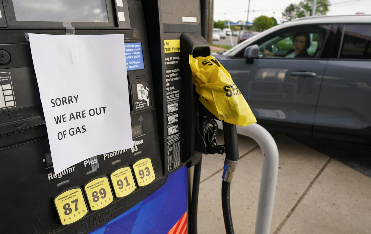A driver looks at a closed gas pump as stations from Florida to Virginia began running dry and prices at the pump rose, as the shutdown of the Colonial Pipeline by hackers sparked buying panic by motorists, in Falls Church, Virginia, U.S., May 12, 2021. (Kevin Lamarque/Reuters)